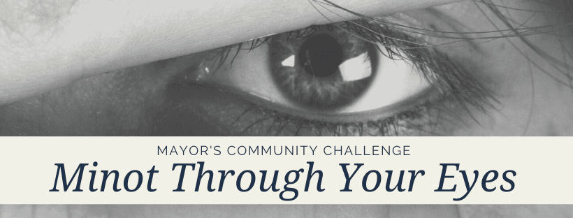 "A graphic of a human eye with wording ""Minot Through Your Eyes"" a Mayor's Community Challen"